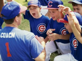 little-league-baseball-team-cheering-with-their-coach